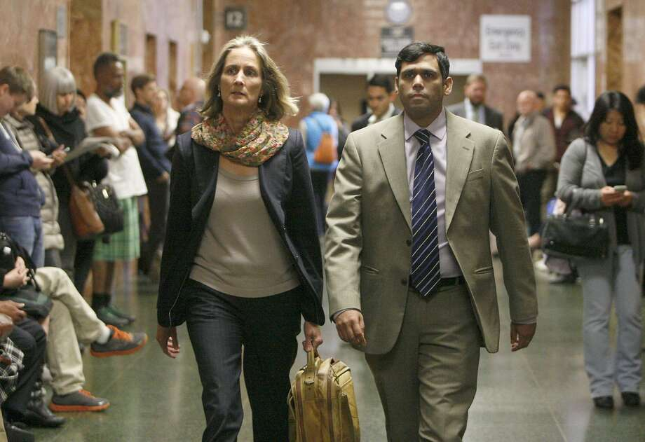 Enrique Pearce, right, and his lawyer Eileen Burke head into a courtroom inside the Hall of Justice, Wednesday, May 13, 2015, in San Francisco, Calif. Pearce a political consultant for S.F. Mayor Ed Lee, was arraigned on child porn possession charges. He pleaded not guilty. Pearce was taken into custody after being deemed a public safety risk by the prosecutor. Bail was set to $400,000. Photo: Santiago Mejia, The Chronicle
