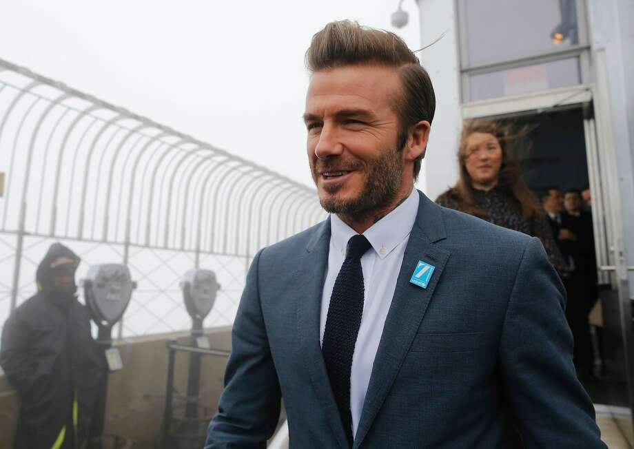 If former professional footballer and underwear model David Beckham can still be cool at in a touristy place like the Empire State Building observation deck, so can you. Photo: EDUARDO MUNOZ ALVAREZ, AFP/Getty Images
