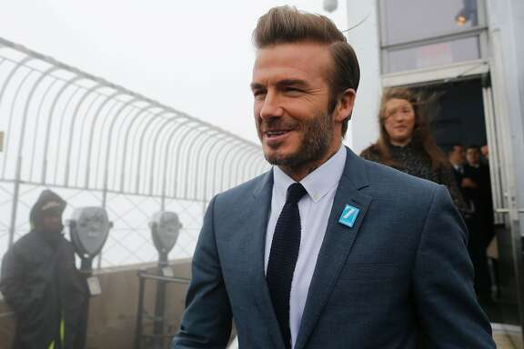 UNICEF Goodwill Ambassador and  former professional footballer David Beckham arrives atop the Empire State Building December 12, 2016 in New York to mark UNICEFs 70th anniversary.  / AFP PHOTO / Eduardo Munoz AlvarezEDUARDO MUNOZ ALVAREZ/AFP/Getty Images