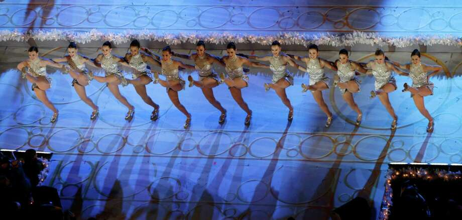 FILE - In this Wednesday, Dec. 4, 2013, file photo, the Rockettes perform before the lighting of the Rockefeller Center Christmas tree in New York. The Radio City Rockettes have been assigned to dance at President-elect Donald Trump's inauguration January 2017. (AP Photo/Kathy Willens, File) Photo: Kathy Willens, STF / AP2013