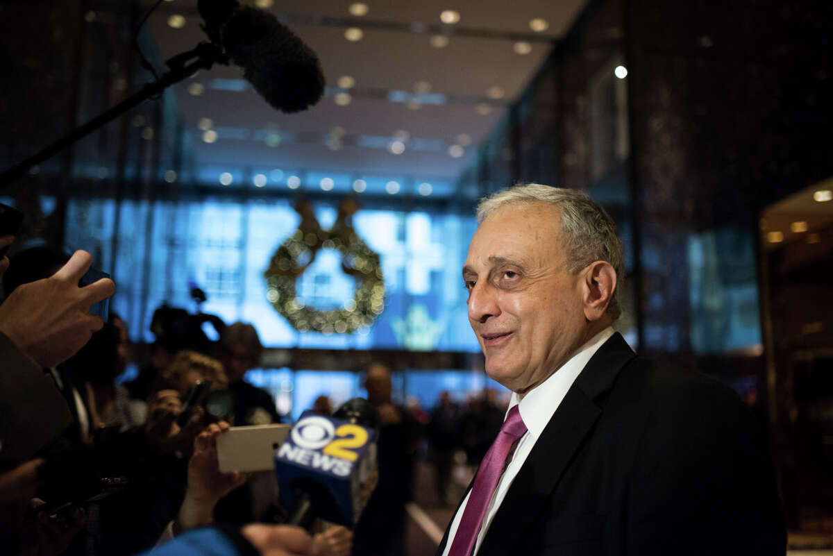 """FILE ?- Carl Paladino, a close political ally of the president-elect, speaks to reporters at Trump Tower in Manhattan, Dec. 5, 2016. Paladino came under fire on Dec. 23 for racially charged comments about President Barack Obama and the first lady, whom he said should be ?""""return to being a male and let loose in the outback of Zimbabwe.?"""" (Hilary Swift/The New York Times) ORG XMIT: XNYT116"""