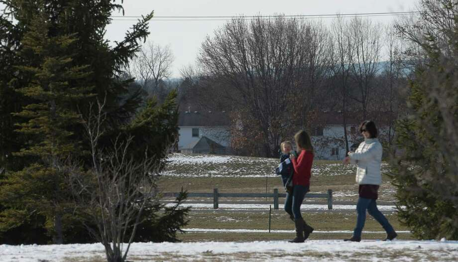 Family members enjoy the warmer than normal winter day for a walk at the Crossings at Colonie Friday Dec. 23, 2016 in Colonie, N.Y.  (Skip Dickstein/Times Union) Photo: SKIP DICKSTEIN