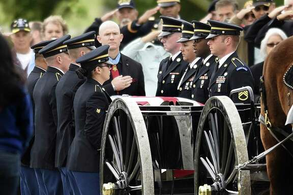 Former Army Staff Sgt. Ty Carter, 36, who wears his Medal of Honor, stands by the caisson as the casket of Army Medal of Honor recipient Santiago J. Erevia is unloaded at Fort Sam Houston National Cemetery on Friday, April 1, 2016. Erevia destroyed four enemy bunkers and tended to wounded comrades during action in Vietnam in 1969. He received the Medal of Honor in 2014 for that action.