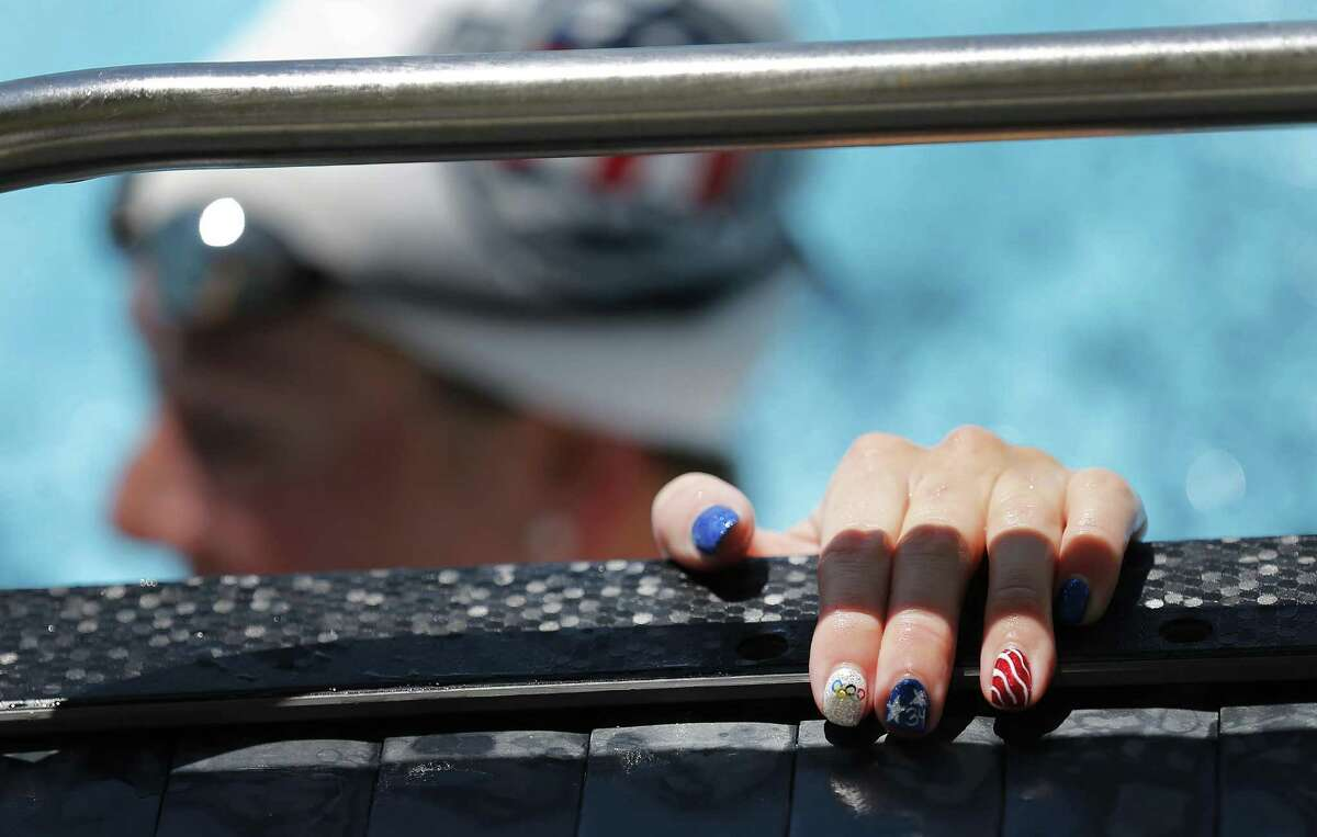 Olympic swimmer Allison Schmitt's fingernails are painted in a patriotic and Olympic theme as the 2016 U.S. Olympic Swimming Team holds practice at Northside Natatorium on Saturday, July 16, 2016. The entire team including Michael Phelps, Ryan Lochte, Katie Ledecky, Missy Franklin and local San Antonian Jimmy Feigen thrilled the crowd as they practiced and swam laps. The team is in final preparation for the upcoming Rio 2016 Olympic Games. (Kin Man Hui/San Antonio Express-News)