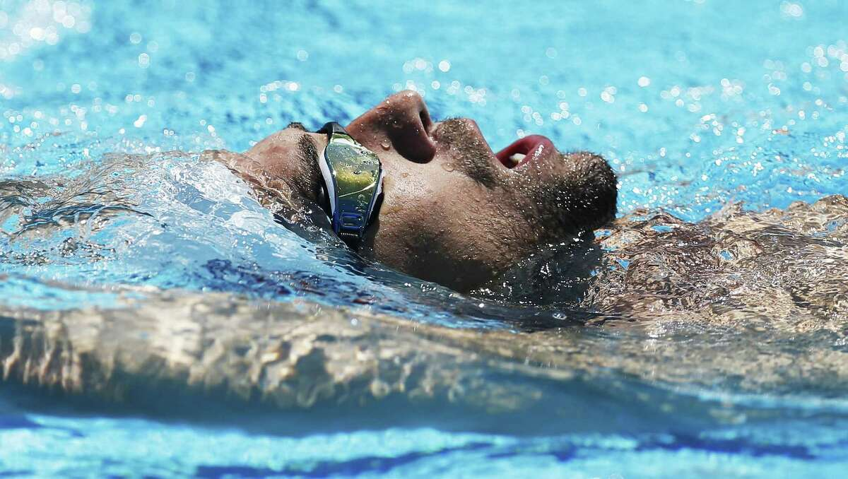 Olympic swimmer Michael Phelps swims laps as the 2016 U.S. Olympic Swimming Team holds practice at Northside Natatorium on Saturday, July 16, 2016. The entire team including Michael Phelps, Ryan Lochte, Katie Ledecky, Missy Franklin and local San Antonian Jimmy Feigen thrilled the crowd as they practiced and swam laps. The team is in final preparation for the upcoming Rio 2016 Olympic Games. (Kin Man Hui/San Antonio Express-News)