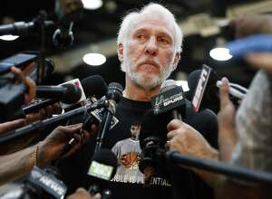 Spurs coach Gregg Popovich keeps his emotions in check as he addresses the media a day after Tim Duncan announced his retirement from the game on Tuesday, July 12, 2016. Popovich wore a t-shirt with the likeness of Duncan as he reflected on his relationship with the 19-year Spurs veteran and talked about his contributions to the team and to him personally. (Kin Man Hui/San Antonio Express-News)