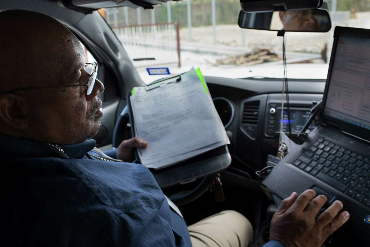 Harris County development investor Byron Adams takes a look at the profile of a new construction site he has been inspecting, Wednesday, Nov. 30, 2016. ( Marie D. De Jesus / Houston Chronicle )