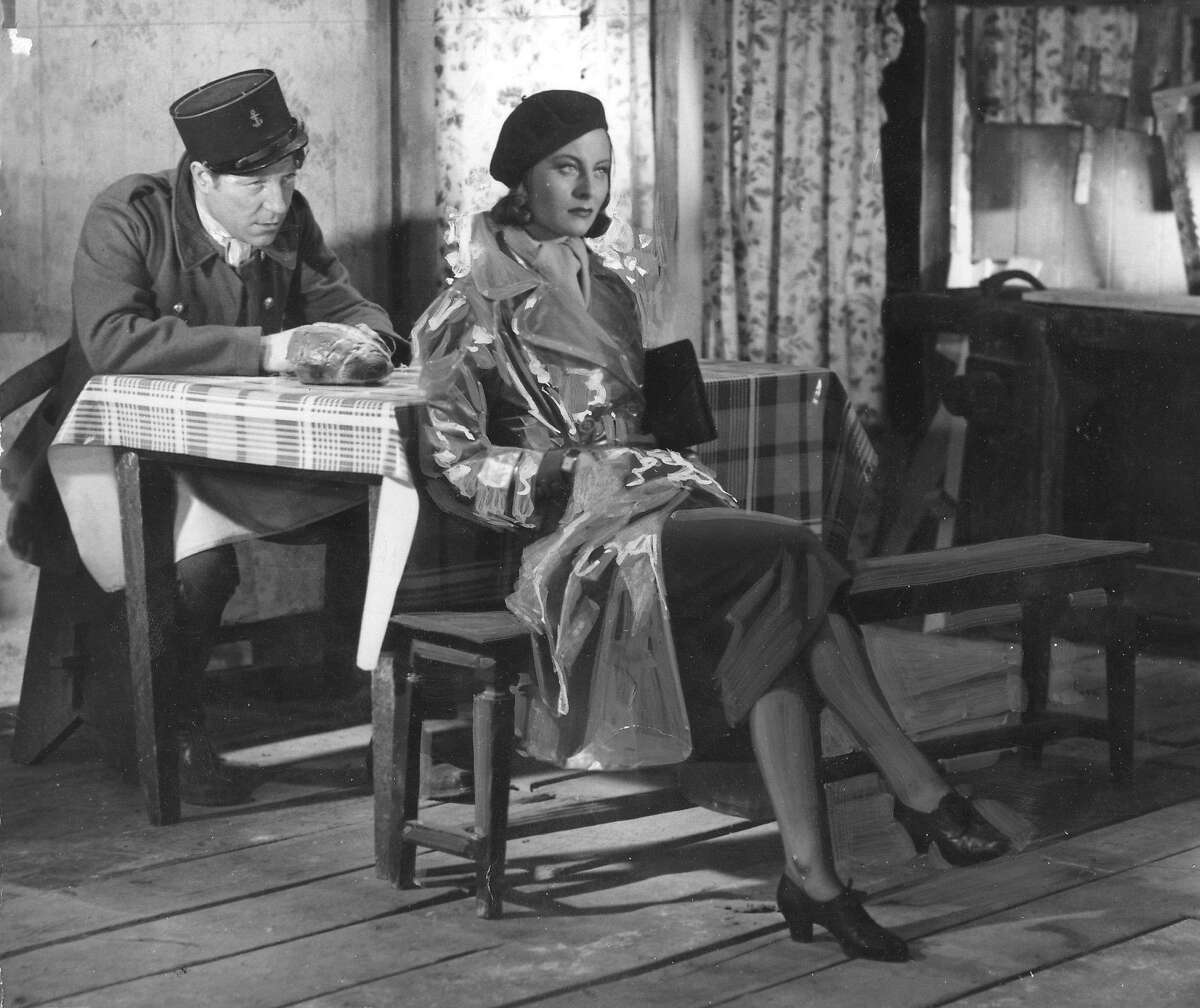 (FILES) This unlocated file photo taken in 1938 shows French actress Michele Morgan (R) and French actor Jean Gabin playing in the film