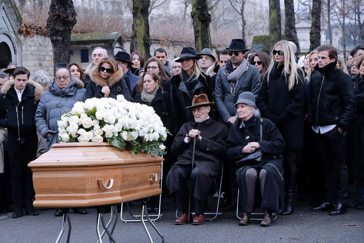 Family of late French actress Michele Morgan, her granddaughter Sarah Marshall (2nd R), her great-grandson Christopher Thompson (R), her sister Helene Roussel (C-R), her brother Paul Roussel (C) and William Marshall (3rd R) attend her funeral at the Saint Pierre church in Neuilly-sur-Seine on December 23, 2016. / AFP PHOTO / FRANCOIS GUILLOTFRANCOIS GUILLOT/AFP/Getty Images