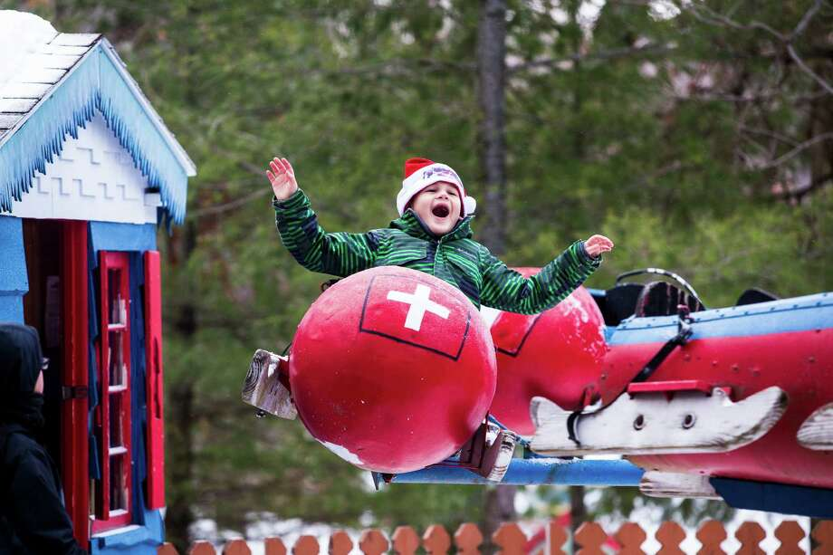 Nolan Battige rides the flying bobsled attraction at Santa's Workshop, one of the last theme parks in the Adirondack regions, in North Pole, N.Y., Dec. 19, 2016. Attendance is dwindling at the Christmas attraction, as tourism in the region slows and Santa's hold over children weakens. (Nancie Battaglia/The New York Times)  ORG XMIT: XNYT134 Photo: NANCIE BATTAGLIA / NYTNS