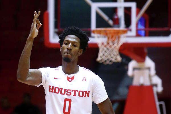 Houston Cougars forward Danrad Knowles (0) celebrates a 3-point shot during the first half of an NCAA basketball game at Hofheinz Pavilion, Friday, Dec. 23, 2016, in Houston.