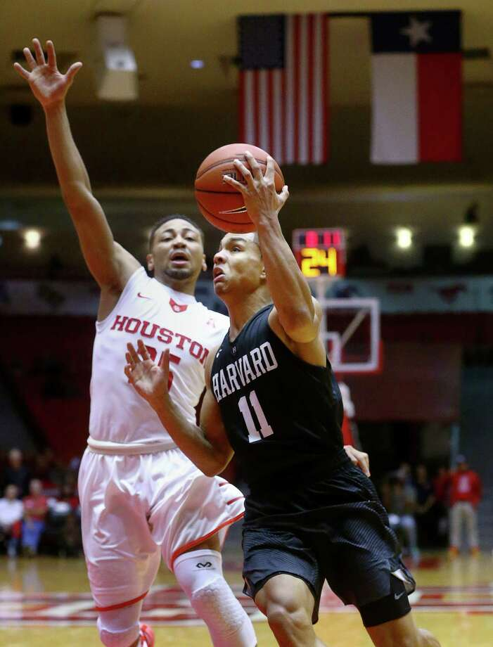 xHarvard Crimson guard Bryce Aiken (11) drives past Houston Cougars guard Galen Robinson Jr. (25) during the second half of an NCAA basketball game at Hofheinz Pavilion, Friday, Dec. 23, 2016, in Houston. Photo: Jon Shapley, Houston Chronicle / © 2015  Houston Chronicle