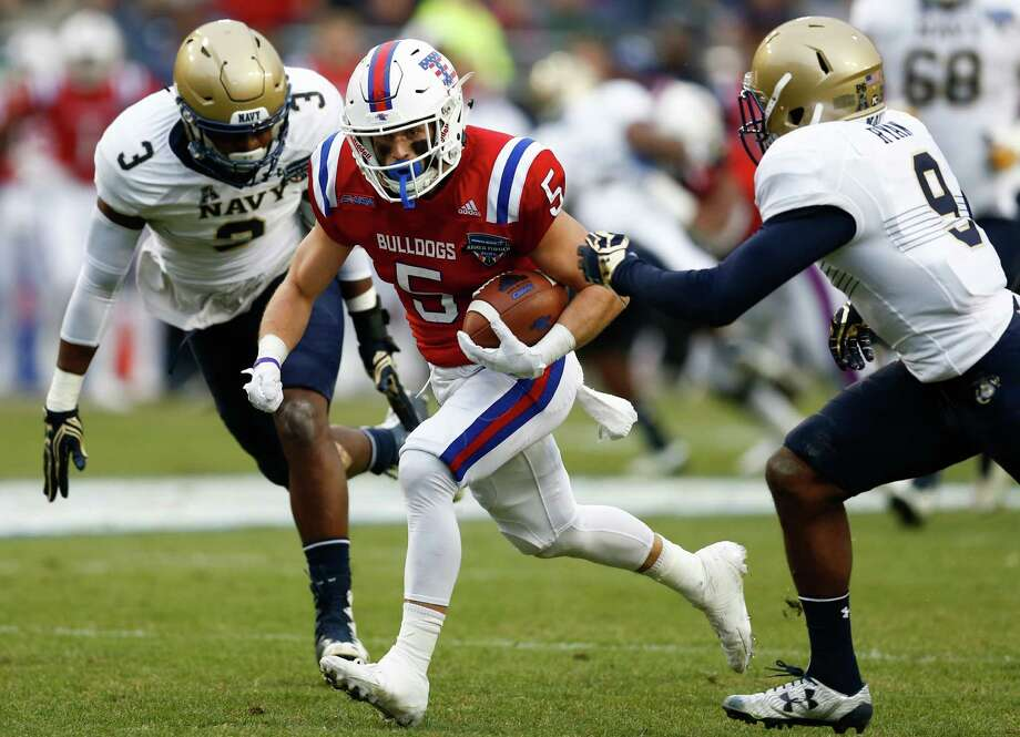 Louisiana Tech wide receiver Trent Taylor (5) runs for a touchdown after a catch past Navy cornerback Jarid Ryan (9) and linebacker Brandon Jones (3) during first half of the Armed Forces Bowl NCAA college football game, Friday, Dec. 23, 2016, in Fort Worth, Texas. (AP Photo/Jim Cowsert) ORG XMIT: TXJC103 Photo: Jim Cowsert / FR170531 AP