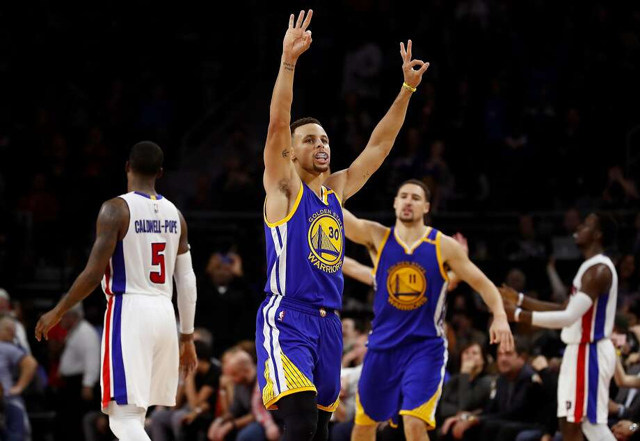Stephen Curry #30 of the Golden State Warriors reacts to a fourth quarter three point basket by teammate Klay Thompson #11 while playing the Detroit Pistons at the Palace of Auburn Hills on December 23, 2016 in Auburn Hills, Michigan.  Photo: Gregory Shamus, Getty Images