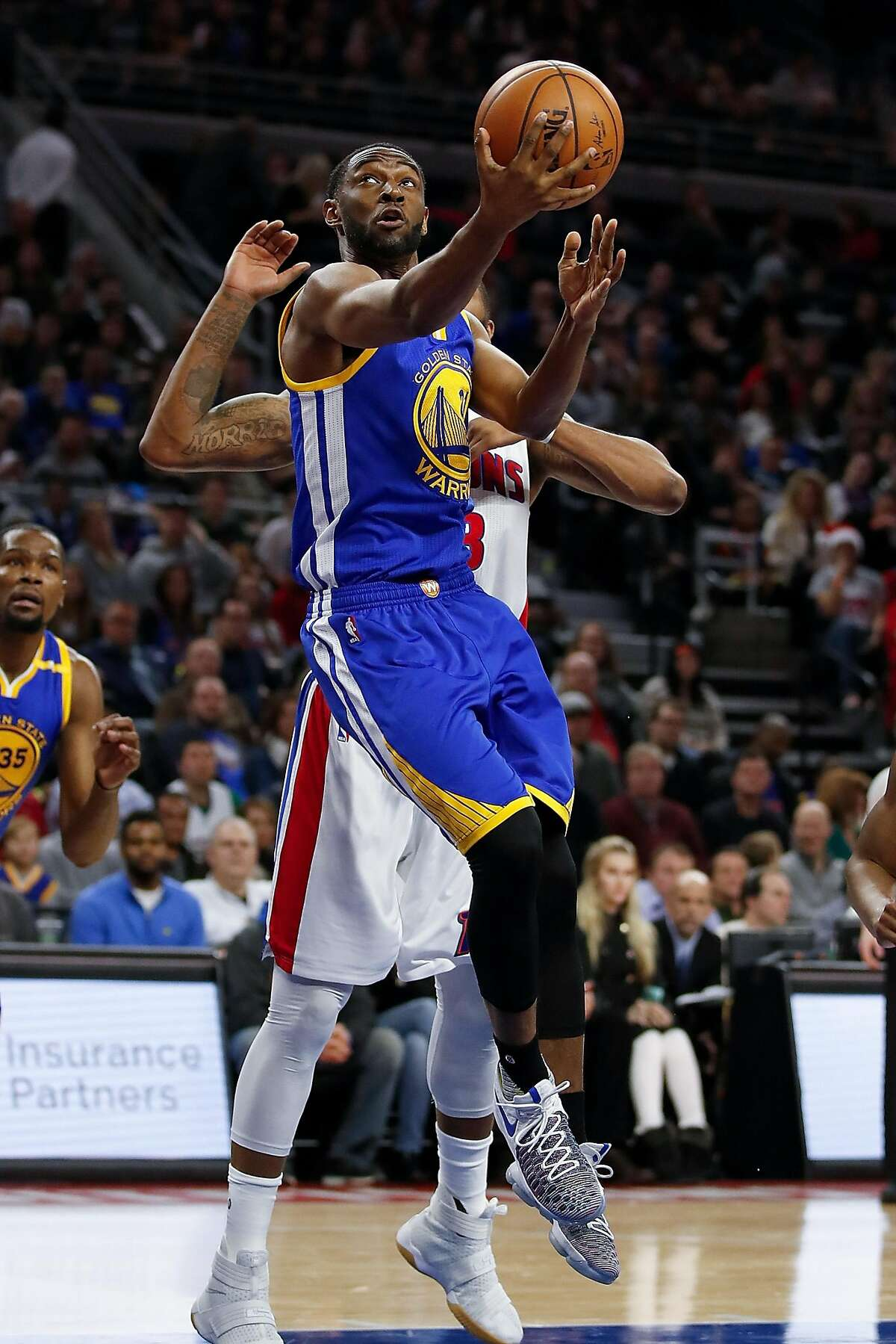 AUBURN HILLS, MI - DECEMBER 23: Ian Clark #21 of the Golden State Warriors tries to get a first half shot off while playing the Detroit Pistons at the Palace of Auburn Hills on December 23, 2016 in Auburn Hills, Michigan. NOTE TO USER: User expressly acknowledges and agrees that, by downloading and or using this photograph, User is consenting to the terms and conditions of the Getty Images License Agreement. (Photo by Gregory Shamus/Getty Images)