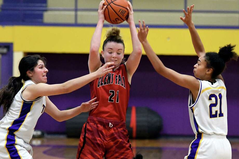 Glens Falls' Lucy Tougas, center, keeps the ball away from Troy's Sabrina Wolfe, left, and Alaina Holmes during their basketball game on Friday, Dec. 23, 2016, at Troy High in Troy, N.Y. (Cindy Schultz / Times Union) Photo: Cindy Schultz / Albany Times Union