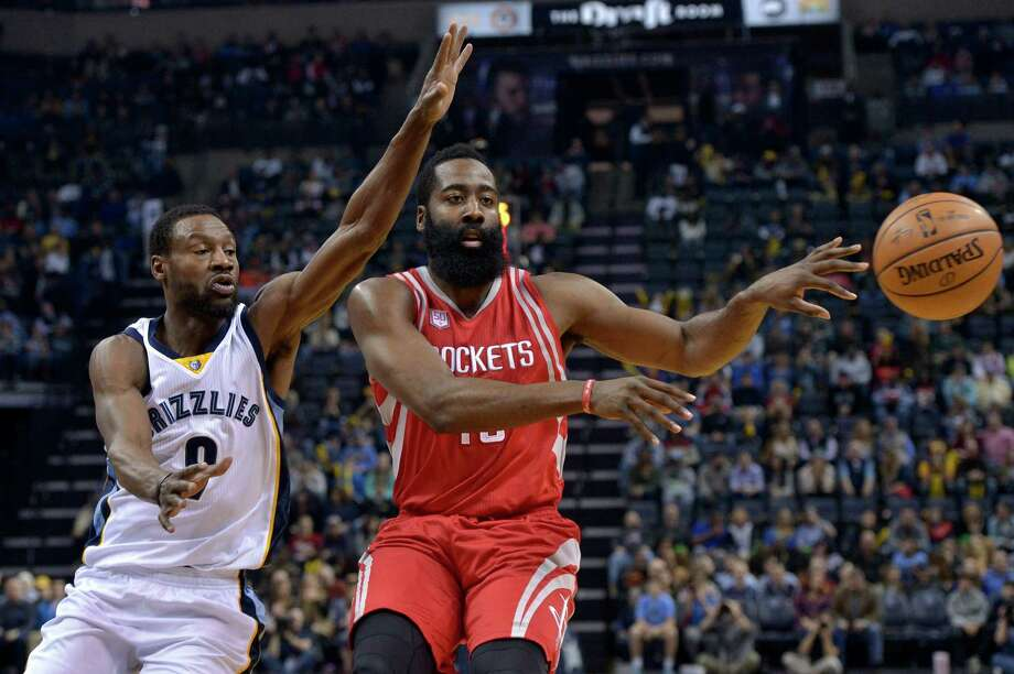 Houston Rockets guard James Harden, right, passes while defended by Memphis Grizzlies guard Tony Allen, left, during the first half of an NBA basketball game Friday, Dec. 23, 2016, in Memphis, Tenn. Photo: Brandon Dill, Associated Press / Invision