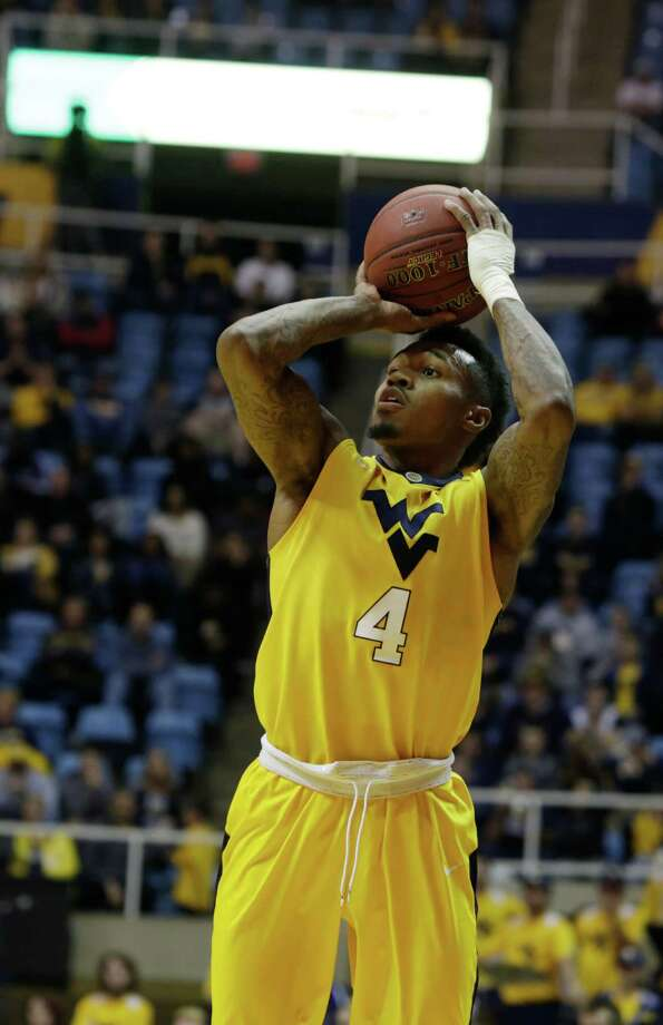 West Virginia guard Daxter Miles Jr. (4) takes a jump shot during the second half of an NCAA college basketball game against Northern Kentucky, Friday, Dec. 23, 2016, in Morgantown, W.Va. (AP Photo/Raymond Thompson) ORG XMIT: WVRT115 Photo: Ray Thompson / FR171247 AP