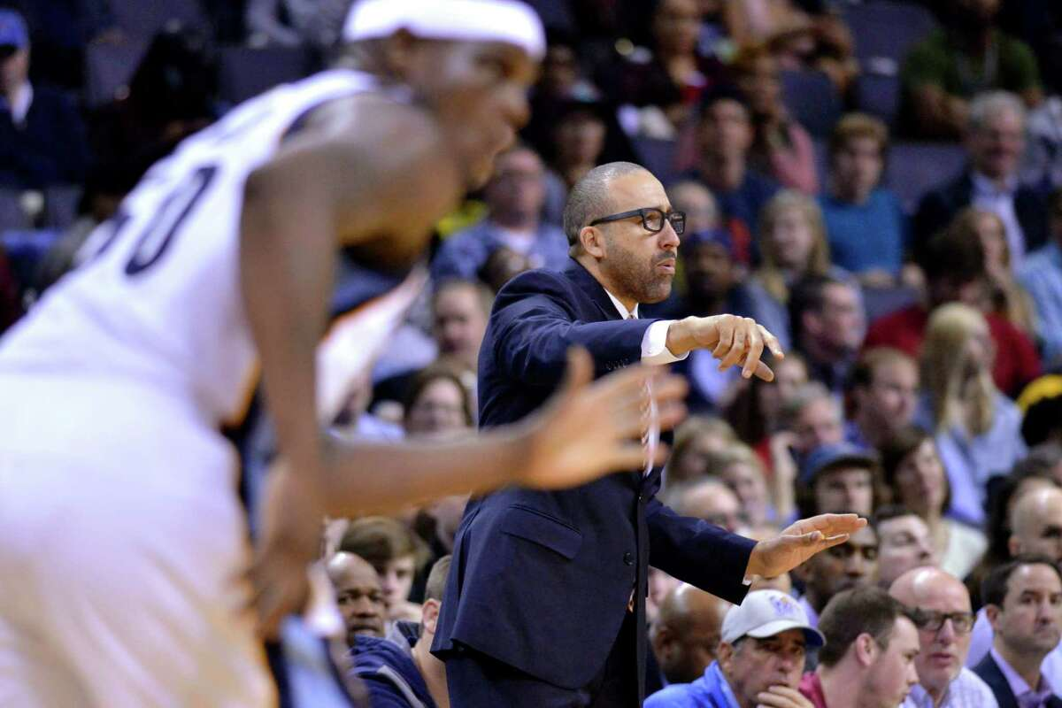 Memphis Grizzlies coach David Fizdale, right, calls to players as Grizzlies forward Zach Randolph (50) runs up the court during the second half of the team's NBA basketball game against the Houston Rockets on Friday, Dec. 23, 2016, in Memphis, Tenn. The Grizzlies won 115-109. (AP Photo/Brandon Dill)