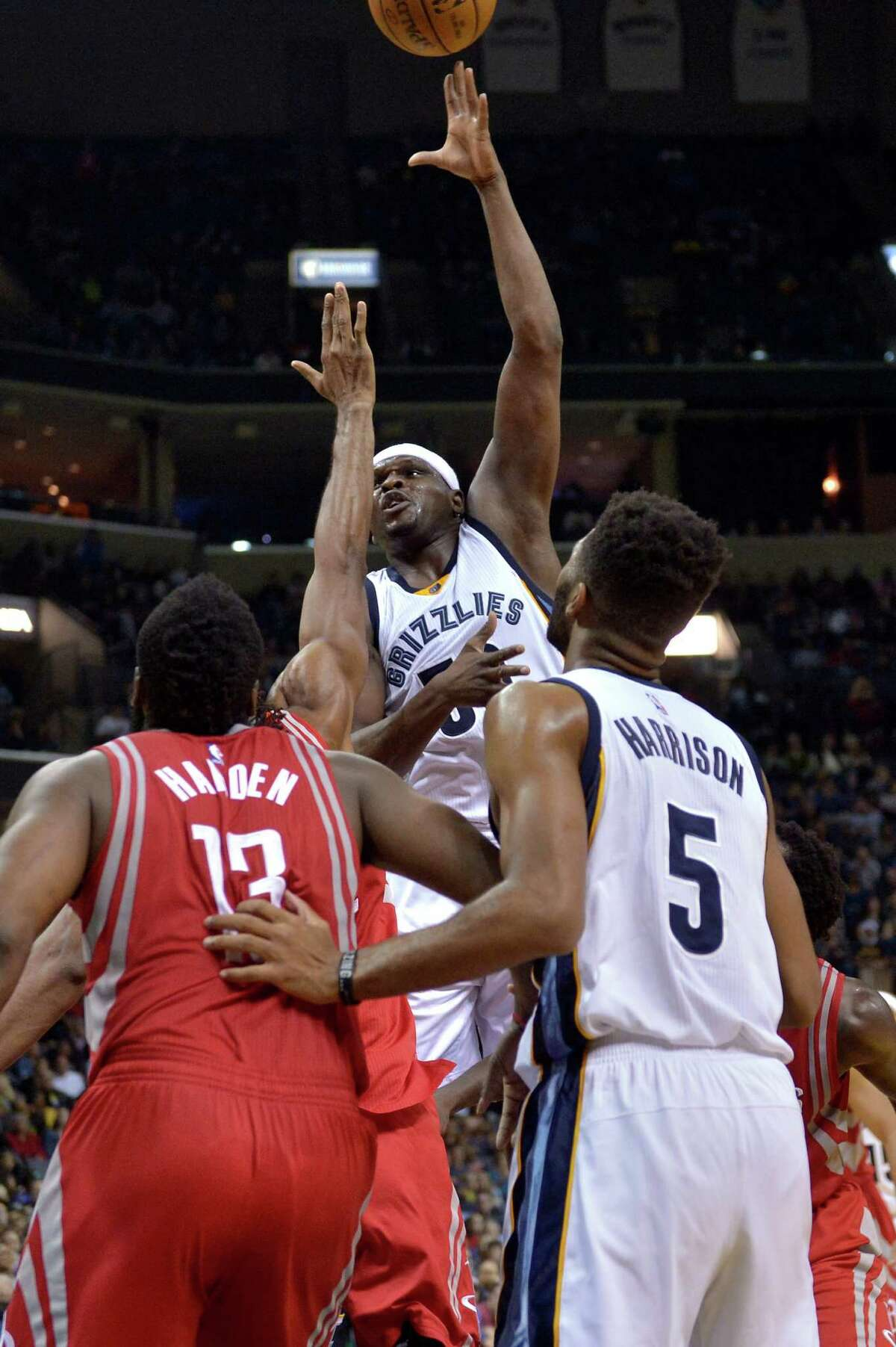 Memphis Grizzlies forward Zach Randolph shoots among a crowd of players including Houston Rockets guard James Harden (13) and Grizzlies guard Andrew Harrison (5) during the second half of an NBA basketball game Friday, Dec. 23, 2016, in Memphis, Tenn. The Grizzlies won 115-109 (AP Photo/Brandon Dill)