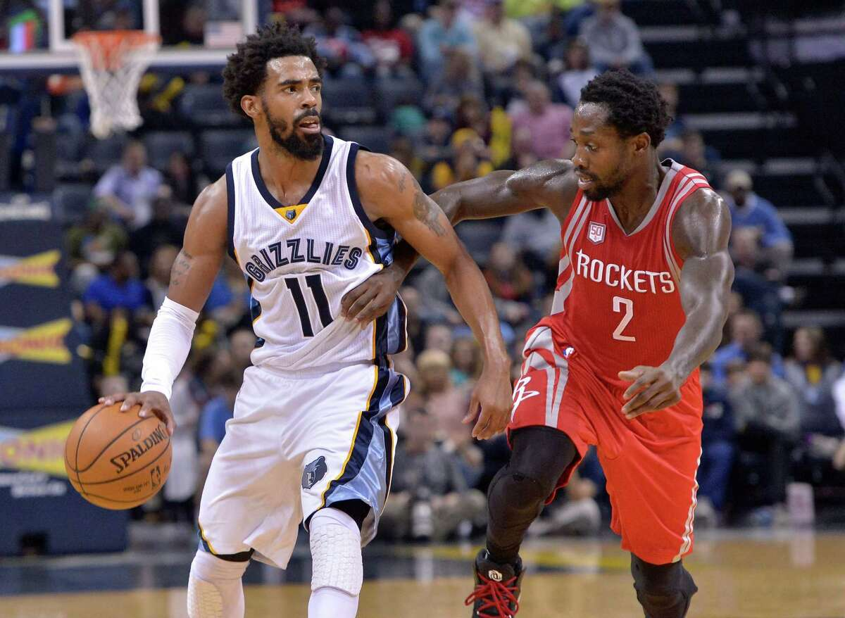 Memphis Grizzlies guard Mike Conley (11) controls the ball against Houston Rockets guard Patrick Beverley (2) during the second half of an NBA basketball game Friday, Dec. 23, 2016, in Memphis, Tenn. (AP Photo/Brandon Dill)