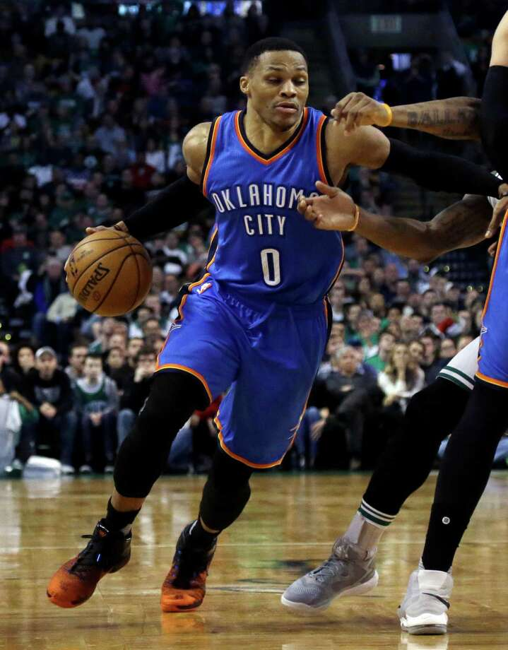 Oklahoma City Thunder guard Russell Westbrook (0) drives with the ball during the fourth quarter of the team's NBA basketball game against the Boston Celtics, Friday, Dec. 23, 2016, in Boston. Westbrook had his 14th triple-double of the season and his third straight 40-point game, scoring 45 with 11 assists and 11 rebounds to lead the Thunder to a 117-112 victory. (AP Photo/Elise Amendola) ORG XMIT: MAEA110 Photo: Elise Amendola / Copyright 2016 The Associated Press. All rights reserved.