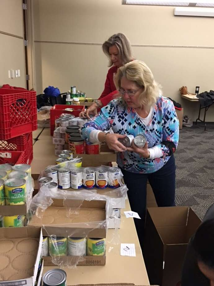 Conroe Noon Lions Club member Jane Johnson sorted, boxed and delivered the annual Christmas baskets to area shut-ins and seniors citizens. Photo: Submitted