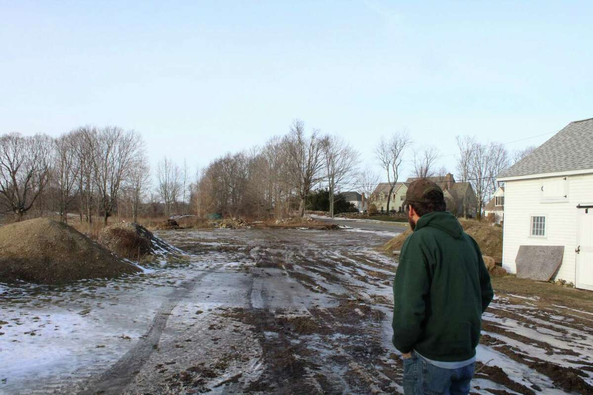 Dan Weed, 23, looking at the tract of land where a barn of his once stood. He changed his farming business after a fire ripped through the barn in October 2015.