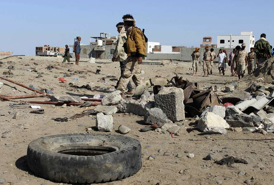 Soldiers gather last Sunday at the site of a suicide bombing at a base in the southern city of Aden. Photo: Wael Qubady, Associated Press