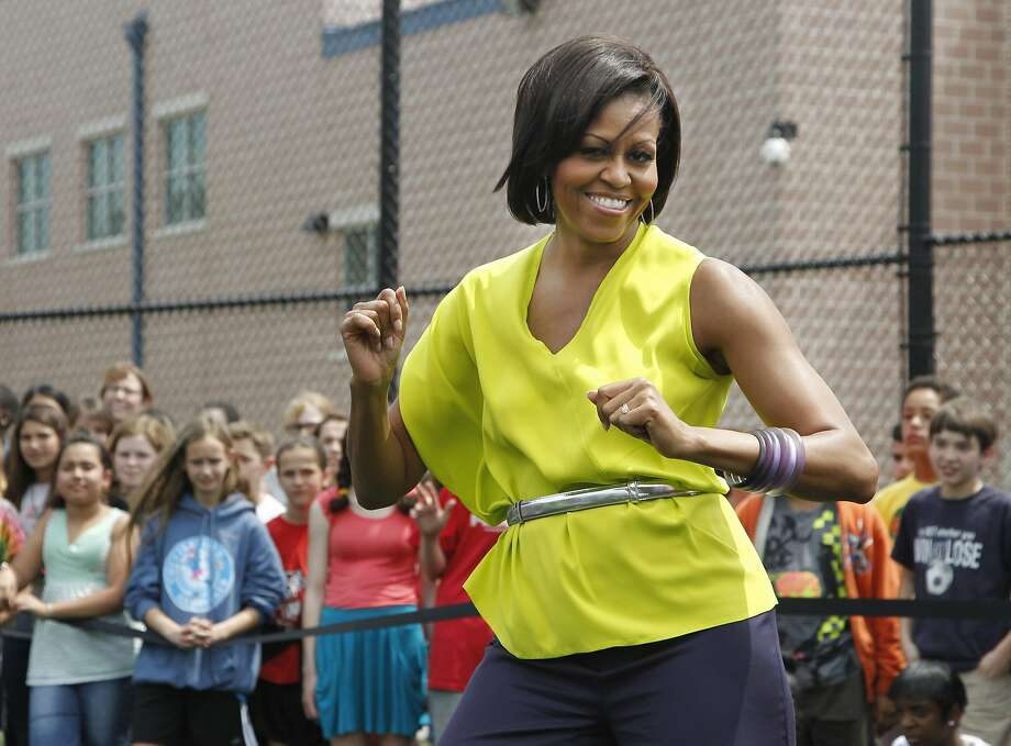 "Michelle Obama dances with students at Alice Deal Middle School in Washington, D.C., during a ""Let's Move!"" event in 2011. Photo: Manuel Balce Ceneta, Associated Press"