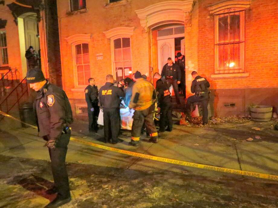 Police and first responders at the scene where a man was shot in the leg on the 300 block of Clinton Avenue in Albany on Friday, December 23, 2016. (Tom Heffernan Sr./Special to the Times Union) Photo: Picasa