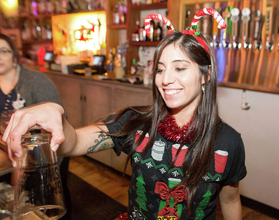 Neighborhood bar The Pigpen celebrated Christmas and its one year anniversary with a huge bash Friday night, Dec. 23, 2016. Photo: By B. Kay Richter, For MySA