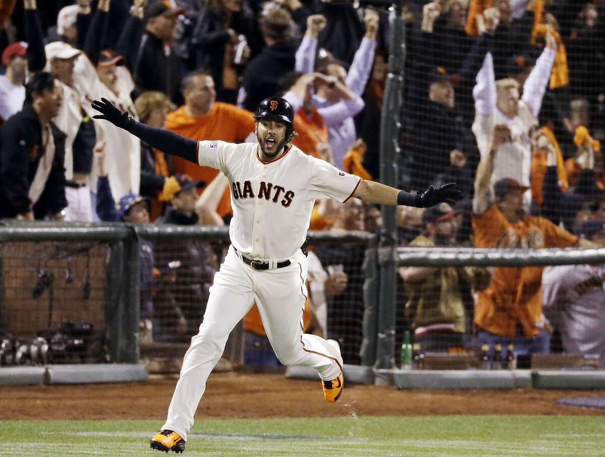 San Francisco Giants' Michael Morse celebrates a home run against the St. Louis Cardinals during the eighth inning of Game 5 of the National League baseball championship series Thursday, Oct. 16, 2014, in San Francisco. (AP Photo/Jeff Chiu)