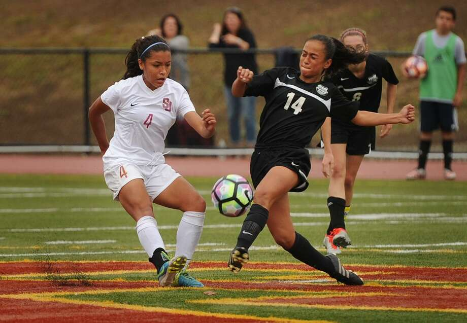 St. Joseph's Jessica Mazo, left, flourished as the quarterback of the Cadets' attack, registering 18 goals and a team-high 25 assists. She was voted the Hearst Connecticut Media girls soccer MVP. Photo: Brian A. Pounds / Hearst Connecticut Media / Connecticut Post
