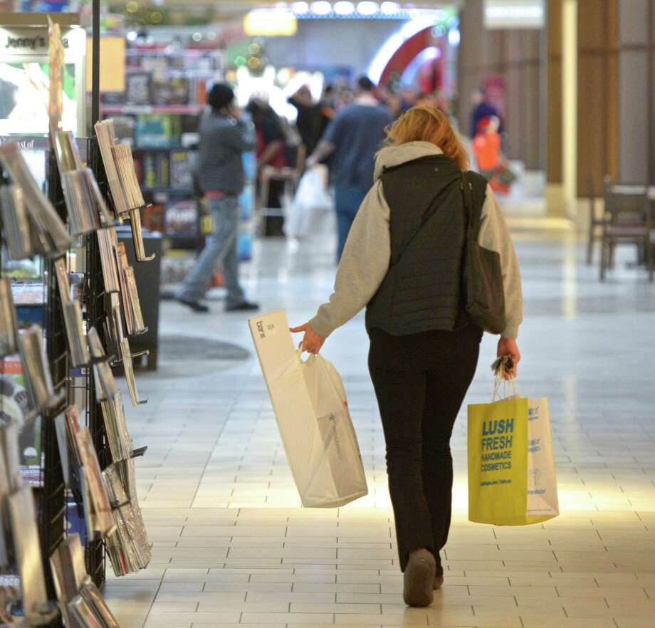 A shopper gets in some last minute gift buying on Christmas Eve at the Danbury Fair Mall, on Saturday, December 24, 2016, in Danbury, Conn. Photo: H John Voorhees III, Hearst Connecticut Media / The News-Times