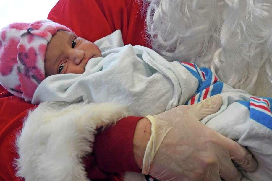 Newborn Isabella Rianna Ganesh has a visit with Santa Claus at Bellevue Women's Center on Saturday Dec. 24, 2016 in Niskayuna , N.Y. (Michael P. Farrell/Times Union) Photo: Michael P. Farrell / 20039239A