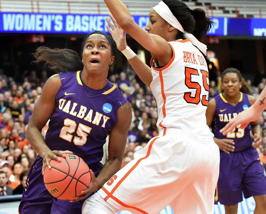 UAlbany's Shereesha Richards, left, works her way to the basket as Syracuse's Bria Day defends during their NCAA second round basketball game on Sunday, March 20, 2016, at the Carrier Dome in Syracuse, N.Y. (Cindy Schultz / Times Union) Photo: Cindy Schultz / Albany Times Union