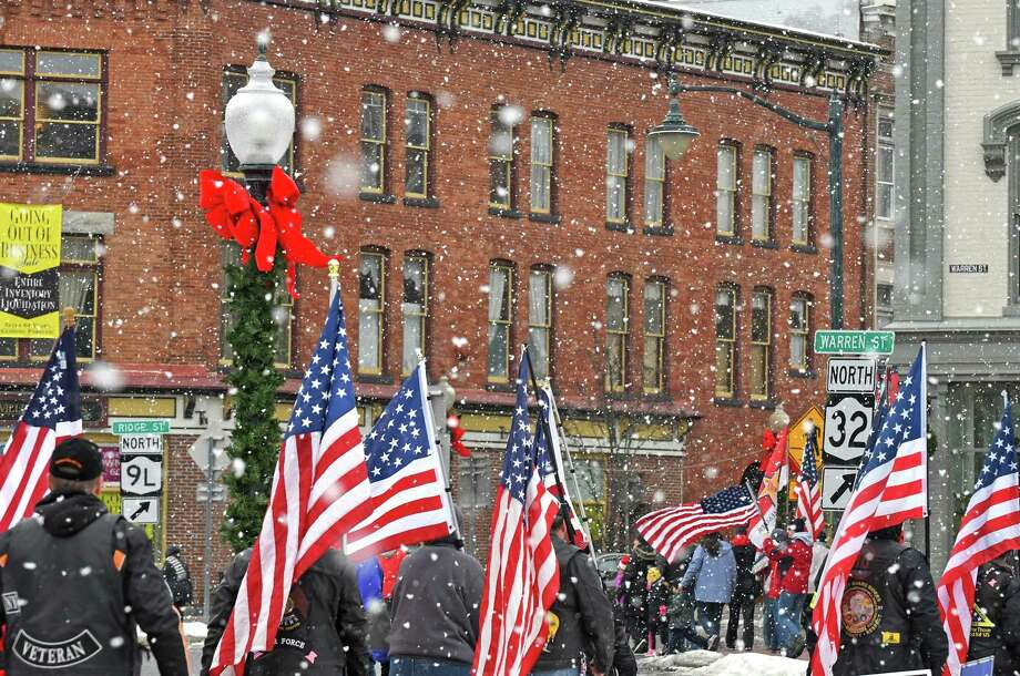 Participants walk in the annual SFC Coon's Christmas Eve Road March on Saturday Dec. 24, 2016 in Glens Falls, N.Y. (Michael P. Farrell/Times Union) Photo: Michael P. Farrell / 20039134A