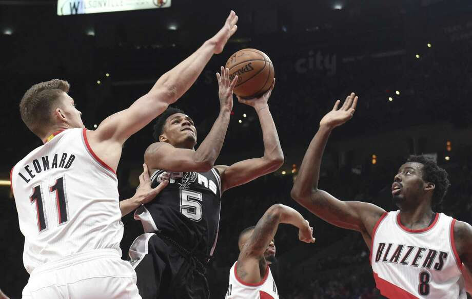 Spurs' Dejounte Murray drives inside against Toronto on Dec. 23. Photo: Steve Dykes /Associated Press / FR155163 AP