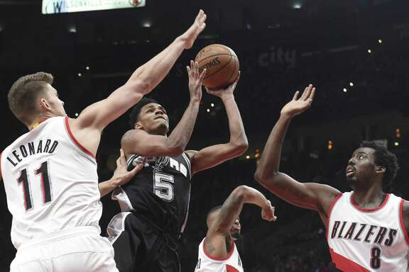 Spurs' Dejounte Murray drives inside against Toronto on Dec. 23.