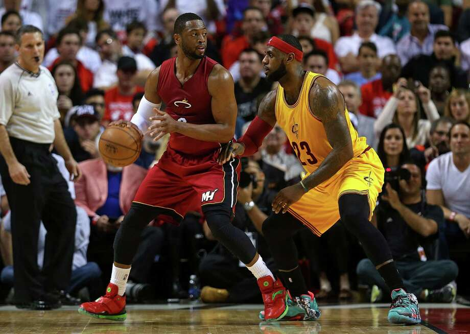 MIAMI, FL - DECEMBER 25:  Dwyane Wade #3 of the Miami Heat posts up LeBron James #23 of the Cleveland Cavaliers during a game  at American Airlines Arena on December 25, 2014 in Miami, Florida. NOTE TO USER: User expressly acknowledges and agrees that, by downloading and/or using this photograph, user is consenting to the terms and conditions of the Getty Images License Agreement. Mandatory copyright notice:  (Photo by Mike Ehrmann/Getty Images) ORG XMIT: 508085263 Photo: Mike Ehrmann / 2014 Getty Images