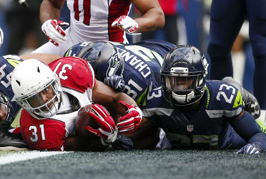 Dec 24, 2016; Seattle, WA, USA; Arizona Cardinals running back David Johnson (31) rushes for a touchdown against Seattle Seahawks free safety Steven Terrell (23) during the first quarter at CenturyLink Field. Mandatory Credit: Joe Nicholson-USA TODAY Sports Photo: Joe Nicholson/USA Today Sports