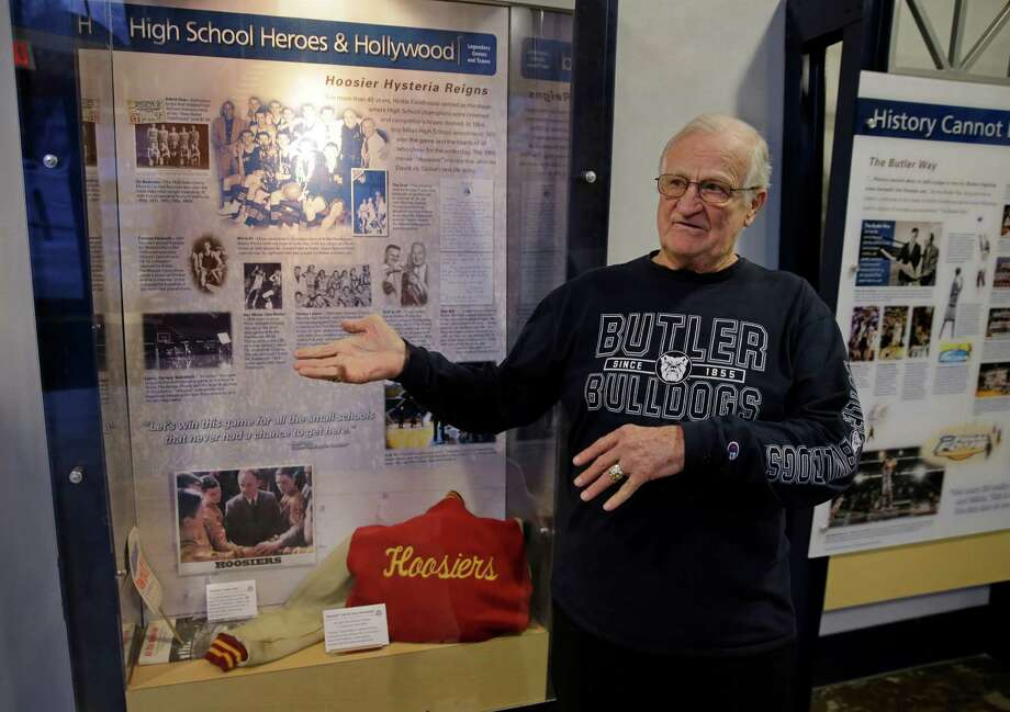 "In this Tuesday, Dec. 20, 2016 photo, Bobby Plump, star of the 1954 Milan state championship basketball team featured in the movie ""Hoosiers,"" talks about a display of movie memorabilia on display at Hinkle Fieldhouse in Indianapolis. Hinkle Fieldhouse was the site of championship game and the filming of the final game in the movie. (AP Photo/Michael Conroy) ORG XMIT: INMC202 Photo: Michael Conroy / Copyright 2016 The Associated Press. All rights reserved."