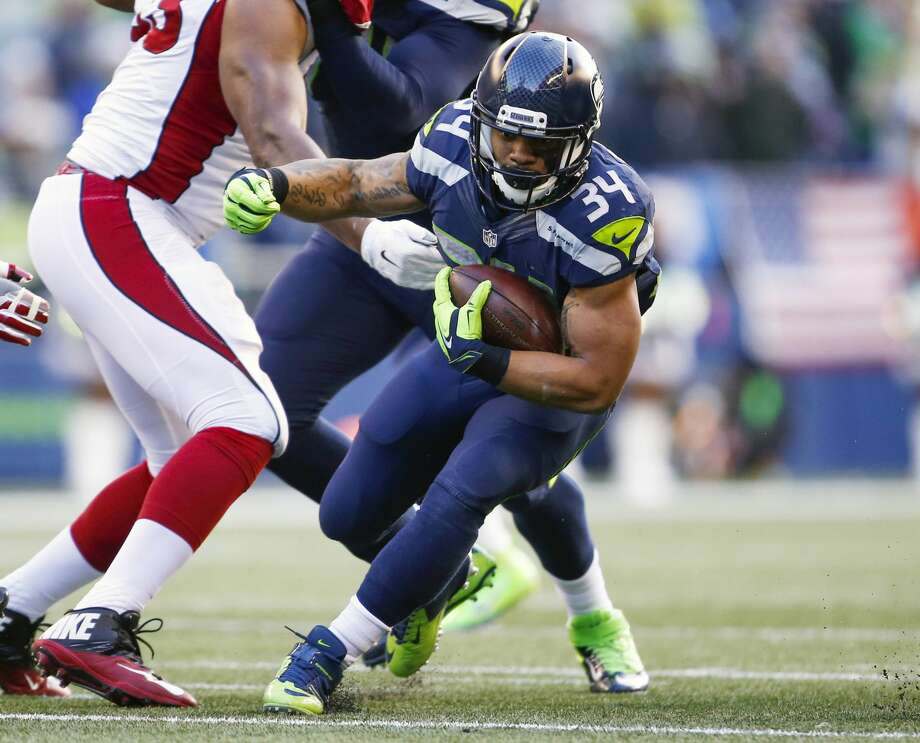 Seattle Seahawks running back Thomas Rawls (34) rushes against the Arizona Cardinals during the first quarter at CenturyLink Field. Mandatory Credit: Joe Nicholson-USA TODAY Sports Photo: Joe Nicholson/USA Today Sports