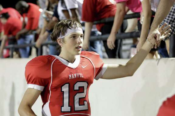 Manvel Mavericks quarterback Kason Martin (12) shakes hands with fans after the high school football game between the Marshall Buffalos and the Manvel Mavericks at Memorial Stadium in Alvin, TX on Friday, October 7, 2016.  The Mavericks defeated the Buffalos 63-6.