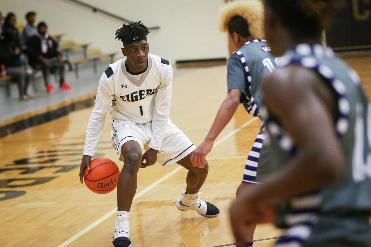ConroeÂ?'s Jay Lewis (1) controls the ball during the varsity boys basketball game against Willis on Monday, Dec. 19, 2016, at Conroe High School. (Michael Minasi)
