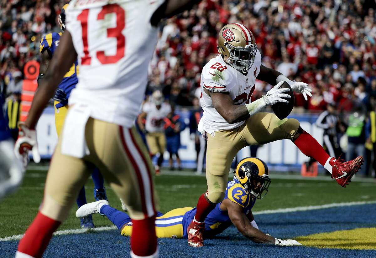 San Francisco 49ers running back Carlos Hyde scores pas Los Angeles Rams' Blake Countess during the first half of an NFL football game against the Los Angeles Rams Saturday, Dec. 24, 2016, in Los Angeles. (AP Photo/Jae C. Hong)