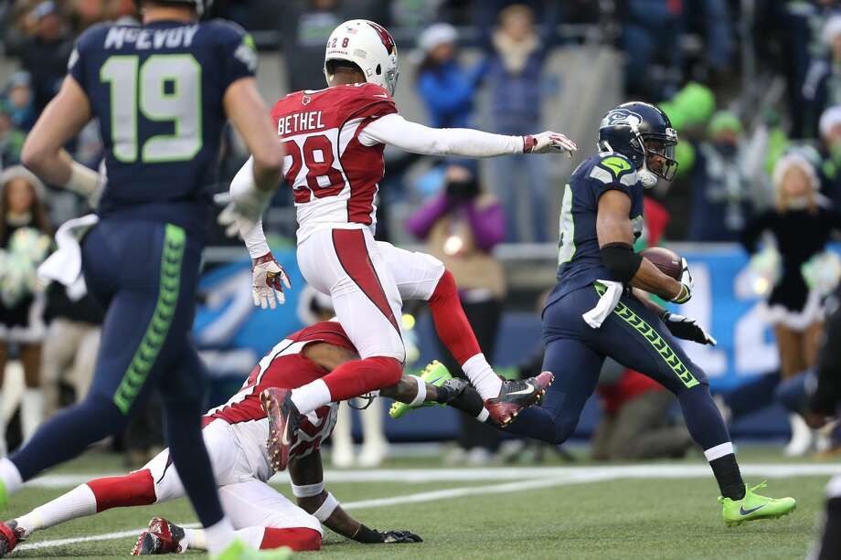 Seahawks receiver Doug Baldwin breaks tackles on the way into the end zone in the fourth quarter against the Cardinals. Photo: GRANT HINDSLEY