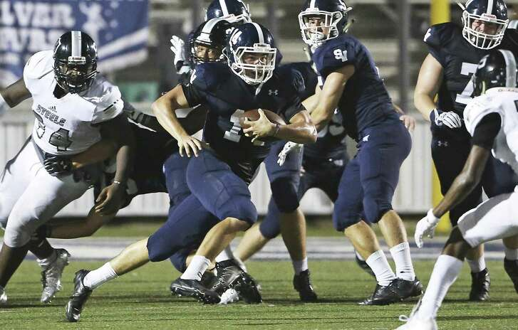 Smithson Valley quarterback Josh Adkins, the 2016 Express-News Offensive Player of the year, scrambles out of the pocket against Steele at Ranger Stadium Stadium on Sept. 16, 2016.