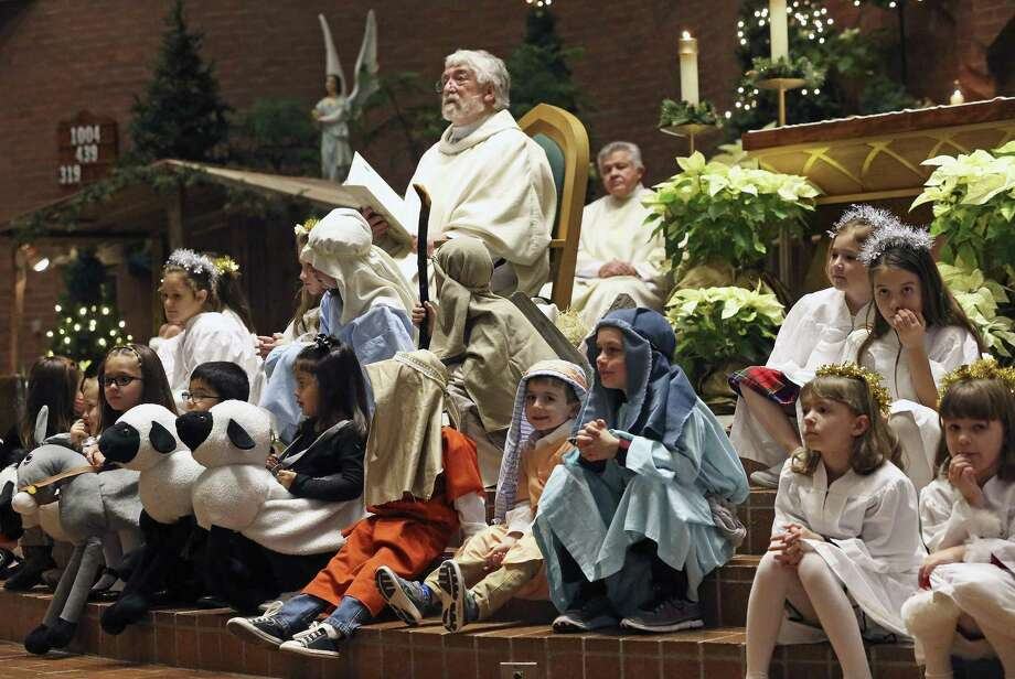 Monsignor Kevin Ryan gives a sermon while children participate in a nativity scene at the altar of St. Mark the Evangelist Catholic Church last year. A reader laments that, for many, Santa Claus has supplanted Jesus as the dominant symbol of Christmas. Photo: Tom Reel /San Antonio Express-News / 2016 SAN ANTONIO EXPRESS-NEWS